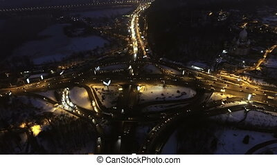 Aerial drone from above view to moving cars. Evening road traffic in Kiev, Ukraine