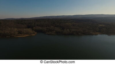 Aerial drone panorama of lake and mountains against sky