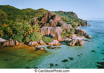 Aerial drone photo of amazing tropical Anse Source D argent beach at Seychelles. Exotic paradise travel vacation concept