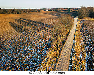 Aerial Drone Photography of a Road in Sunny Winter Day