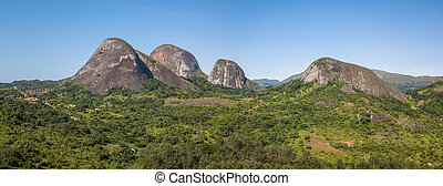 Aerial drone photography of a tropical landscape, with forest and mountains Kumbira forest reserve, small village and huge geologic rock elements, on Conda, Sumbe, Angola