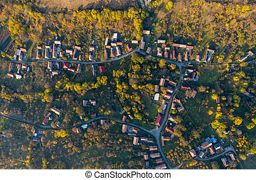 Aerial drone point of view of village streets in the autumn...