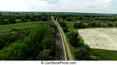 Aerial drone shot country side with road
