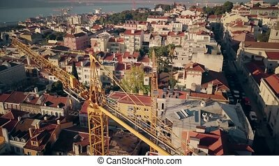 Aerial Drone Shot of Construction Crane in Lisbon.