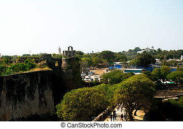 Aerial drone shot of Diu fort with the greenery, ocean and the ruins of the buildings clearly visible