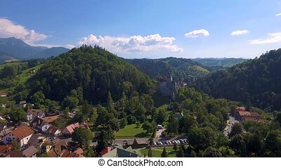 Aerial drone shot of medieval castle in the mountains