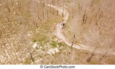 Aerial drone shot view of one enduro motorcycle drive