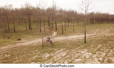 Aerial drone shot view of one enduro motorcycle drive...