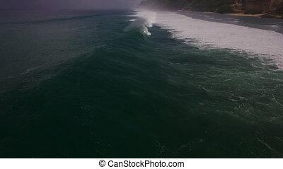 Aerial drone slow motion footage of ocean waves breaking...