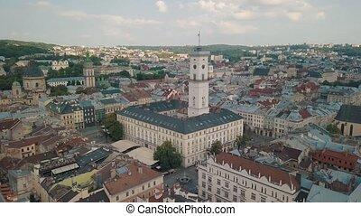 Aerial drone video of european city Lviv, Ukraine. Rynok Square, Central Town Hall, Dominican Church