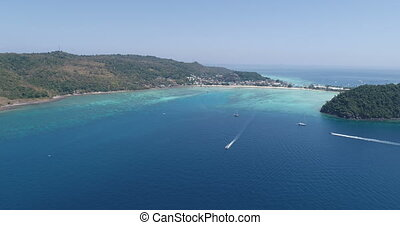 Aerial drone video of iconic tropical beach and resorts of...