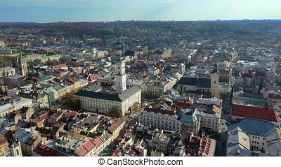 Aerial drone video of Lviv Old City center - roofs and streets, city hall Ratusha
