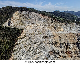 Aerial drone view at quarry among mountains landscape