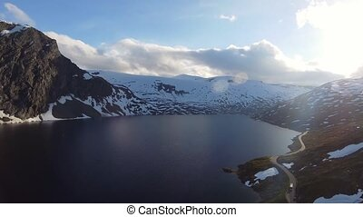Aerial drone view mountain road by the lake in Norway.