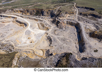 Aerial drone view of a limestone quarry, open pit mine