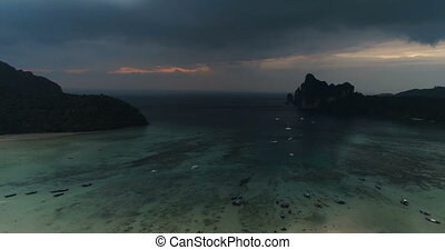 Aerial drone view of boats on the sea over dramatic cloudy...