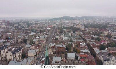 Aerial drone video of city Lviv, Ukraine. Flight above roofs and streets. Panorama of ancient popular central part of old European town Lvov, Ukraine. 4K footage. Church of Saints Olga and Elizabeth