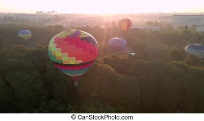 Aerial drone view of colorful hot air balloon flying over ...