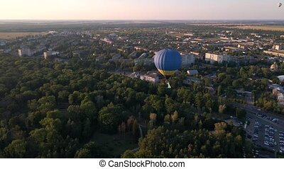 Aerial drone view of colorful hot air balloons flying over ...