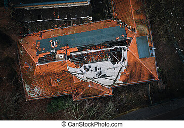 aerial drone view of damaged house Roof