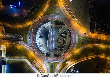 Aerial drone view of roundabout in Katowice at night.