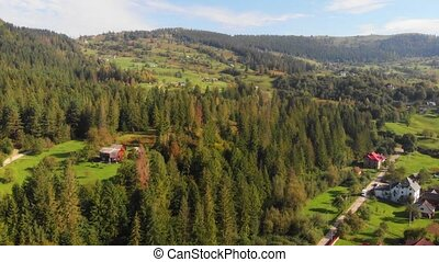Aerial drone view of rural village in the Ukrainian Carpathian Mountains