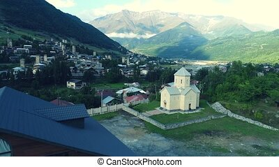 Aerial drone view of Saint Nicholas church in Mestia,...