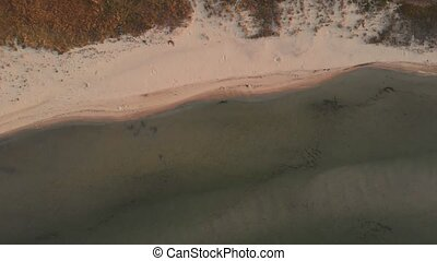 Aerial drone view of sea and coastline.
