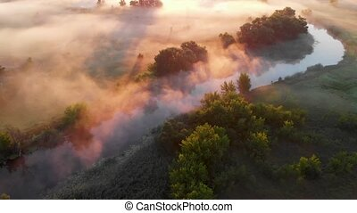 Aerial drone view of sunrise over misty river. Calmness, ...