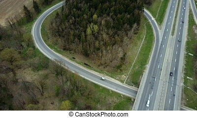 Aerial drone view of the traffic countryside roadway near...