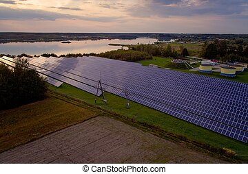 Aerial drone view on solar panels in green renewable energy solar farm