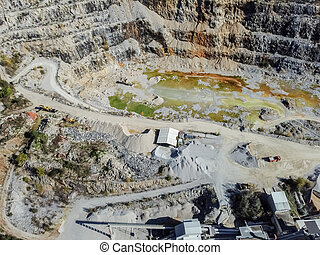 Aerial drone view quarry and polluted pond with green water
