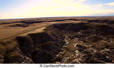Aerial Drumheller Canyon - Flight over arid landscape...