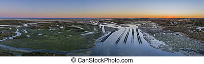 Aerial dusk seascape of oyster production, in Ria Formosa...