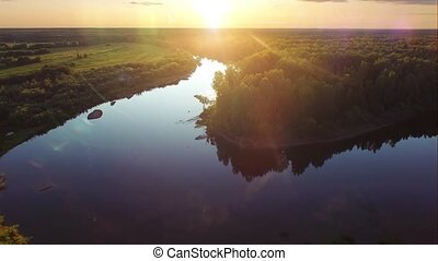 Aerial ecological river forest sunset beautiful shot. Ideal background for forest conservation, save biology and nature, save lakes and rivers, ecology theme. Global warming and forest fire theme.