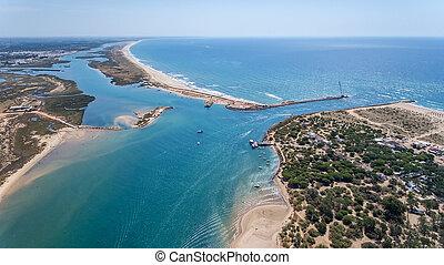 Aerial. Entrance to the bay Quatro aguas. Tavira Island. Taken from the sky.