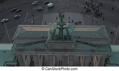 AERIAL: Epic close up view of Brandenburg Gate in beautiful sunset light revealing car traffic in background 4K