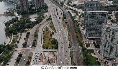 Aerial establishing shot of a generic, non-descript metropolitan city. 4K Cinematic footage.
