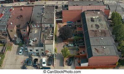Aerial establishing shot of an empty alley in a big city....