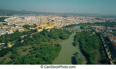 Aerial establishing shot of Cordoba from the Guadalquivir river