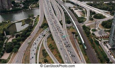 Aerial establishing shot of highway traffic on an overcast...