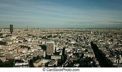 Aerial establishing shot of Paris involving the Eiffel tower, France