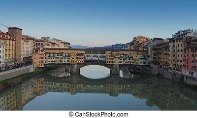 Aerial establishing shot of Ponte Vecchio bridge in...