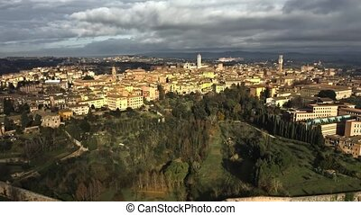 Aerial establishing shot of the city of Siena. Tuscany, Italy