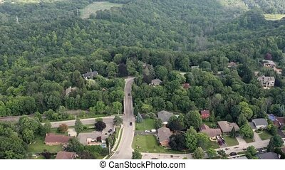 Aerial Establishing Shot of the Suburbs in Late Spring,...