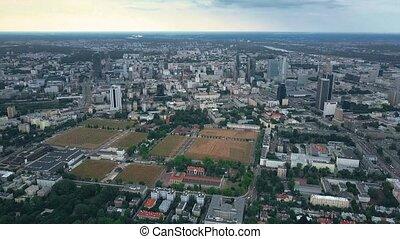 Aerial establishing time lapse shot of Warsaw, Poland -...