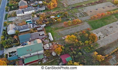 Aerial fall foliage view of rural village, during the sunset
