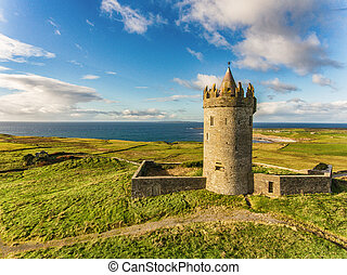 Aerial Famous Irish Tourist Attraction In Doolin, County Clare, Ireland. Doonagore Castle is a round 16th-century tower Castle. Aran Islands and along The Wild Atlantic Way