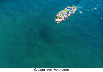 aerial ferry in the sea on a sunny day blue water