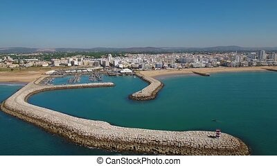 Aerial. Fishing port with boats, filmed from the sky drone in Quarteira.